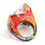 Fancy Carvved Ring with Trillion Channel Set Gem